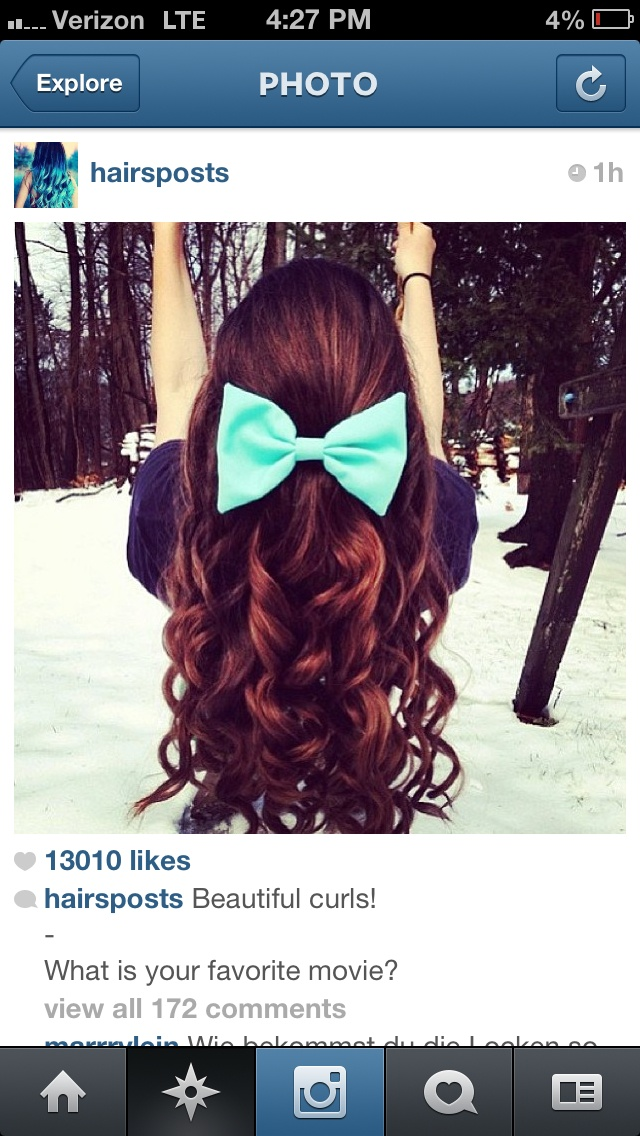 Super cute hair style!!! curly hair with a bow looks adorable!