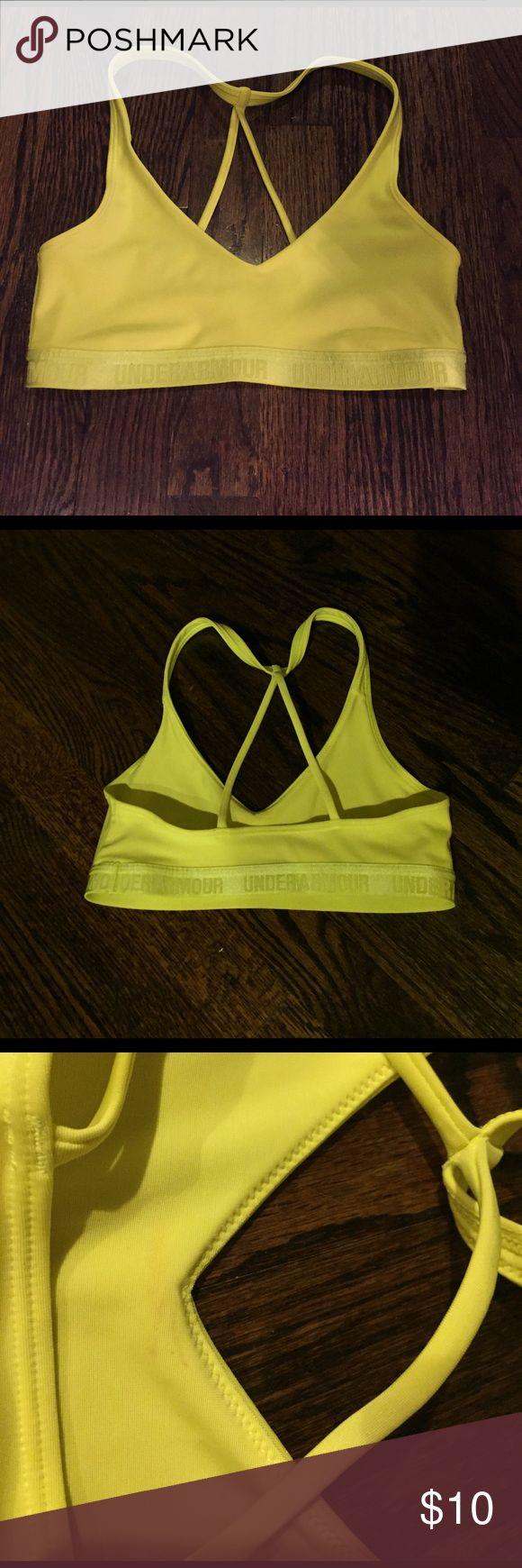 Under Armour Women's Sports Bra Women's Under Armour neon yellow sports bra strappy size XS Never worn, has small stain on inside, NWOT Under Armour Intimates & Sleepwear Bras