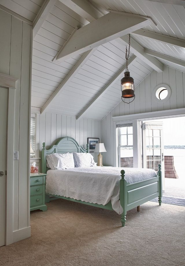 Nantucket Cottage Bedroom | Love the vaulted ceilings with exposed beams, glass doors and washboard walls.