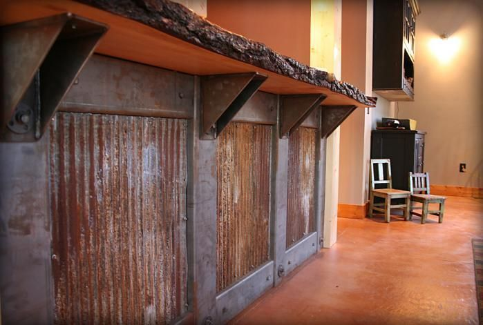 rustic outside wood and tin doors | Rustic reclaimed tin with wood slab counter top...tin cabinet front