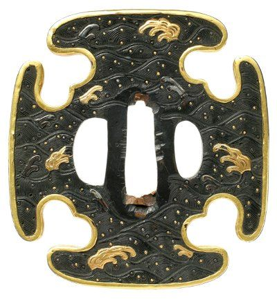 Bronze and gold tsuba, depicting stylized waves.