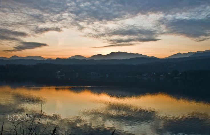 Sunset on the lake - sunset on Lake Avigliana, with colorful reflections on the lake surface