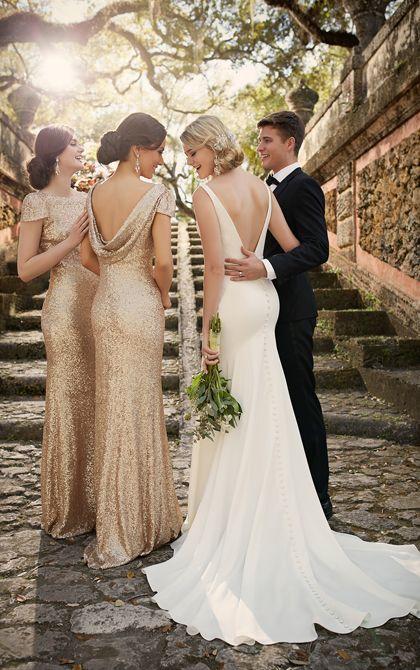 Loredana: This classic, yet modern crepe sheath silhouette bridal gown features a detachable beaded crepe belt, plunging neckline, and a pretty chapel train.#Eleganza #Bridal #WeddingDress #Classica #Loredana