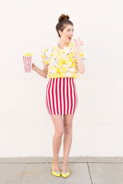 POPCORN: Put together this fun costume with a red and white striped skirt, crumpled paper, and yellow paint. Pro tip: hack the striped skirt with white tape or fabric paint. See the full tutorial and more foodie Halloween costumes here!