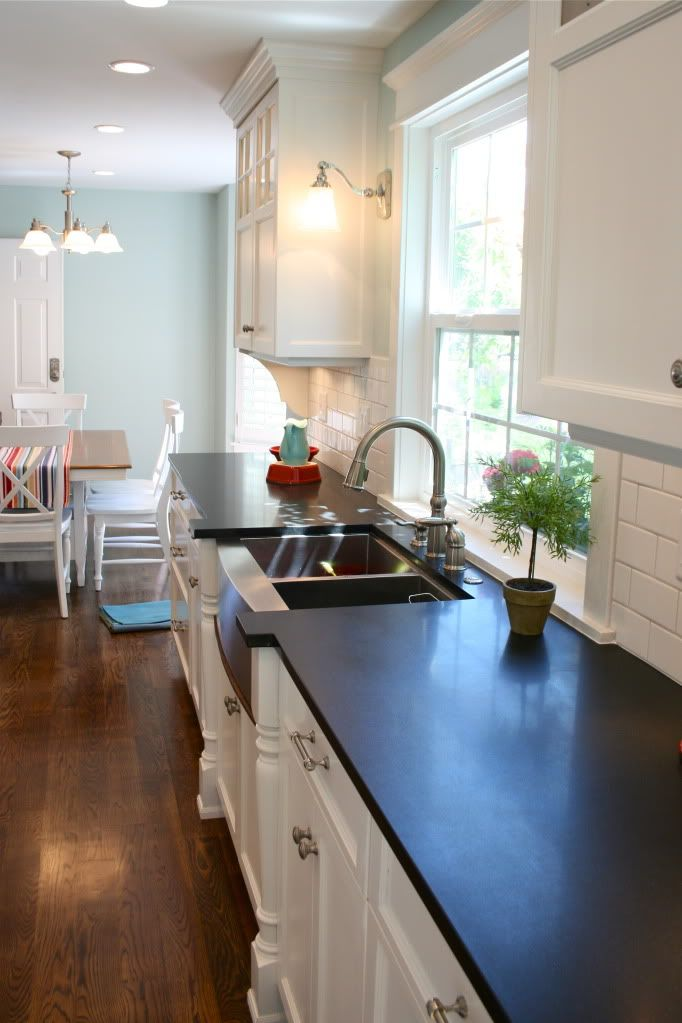 Beautiful Beachy Kitchen Design With White Shaker Cabinets Soapstone Counter Tops Stainless Steel Apron Sink And Subway Tiles Backsplash
