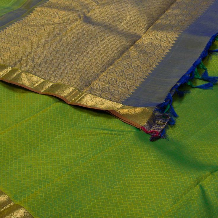 "The ""Green"" #handwoven Kanjivaram Silk Sari from Parisera is set off by a gold…"