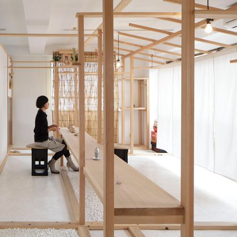 Wooden posts and beams frame displays at Tokyo shop by Fumihiko Sano
