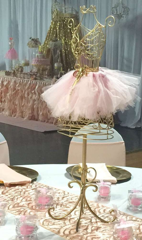 Pretty centerpiece at a pink and gold princess baby shower party! See more party planning ideas at CatchMyParty.com!