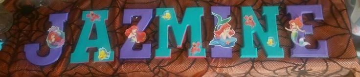 Bought unfinished wood letters ( not painted) and painted with acrylic paint. and glued on pictures with glue gun.