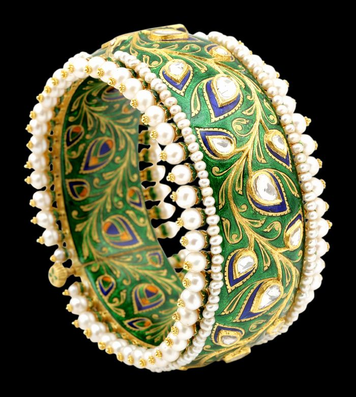 Green enamel peacock-feather bangle with pearl on edges, by Sunita Shekhawat Jewellery Designer, Jaipur, Rajasthan, India