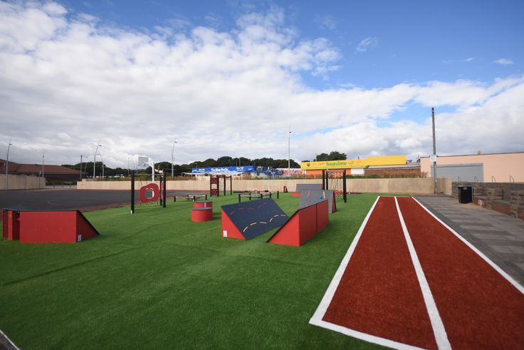 Seafront Ninja Fitness obstacle course on artificial grass with sprint track.