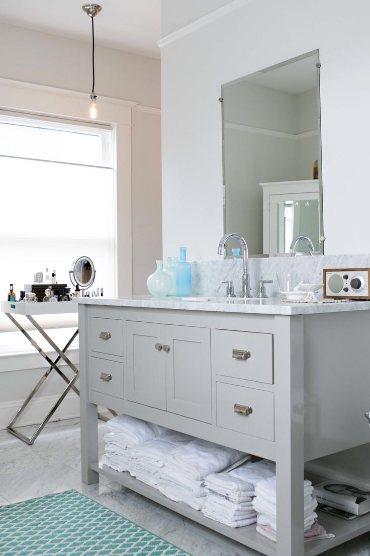 """The vanity in the master bath is painted the same color as the kitchen cabinets- Benjamin Moore """"Baltic Gray."""""""