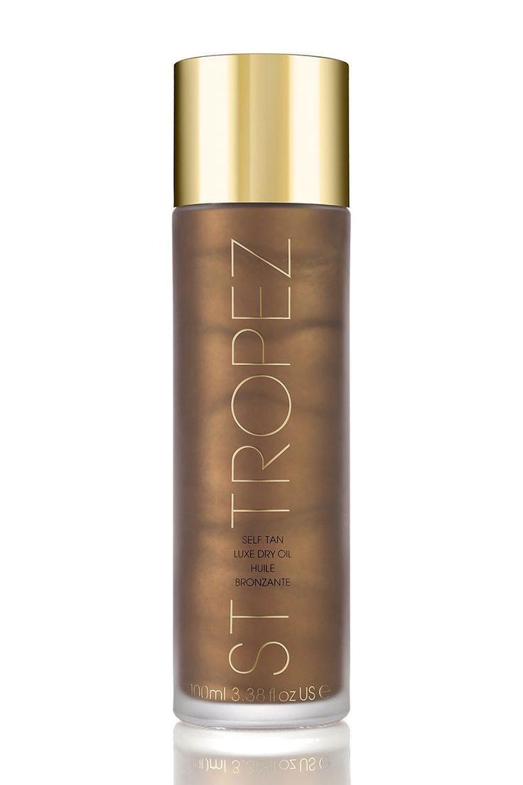 """Kristyn's Tip: """"Not only does the skin feel supple while you're applying, but the presence of oil helps the tan last longer."""" Editor's Pick: St. Tropez Self Tan Luxe Dry Oil, $50, sephora.com.   - HarpersBAZAAR.com"""