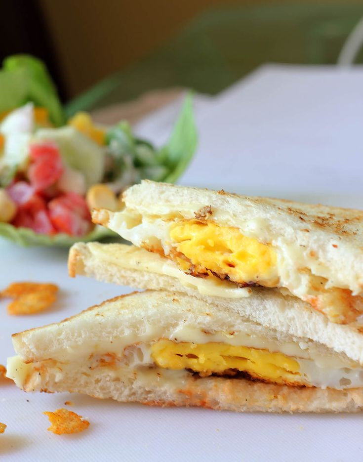 Easy dinner - fried eggs, cheese and chili sauce sandwich.   http://monicabhide.com/indian-express-fried-egg-cheese-and-chili-sauce-sandwich/