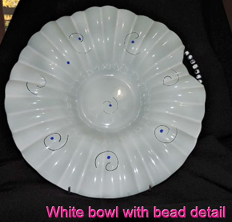 Lovely large white fluted bowl with handmade bead decoration.