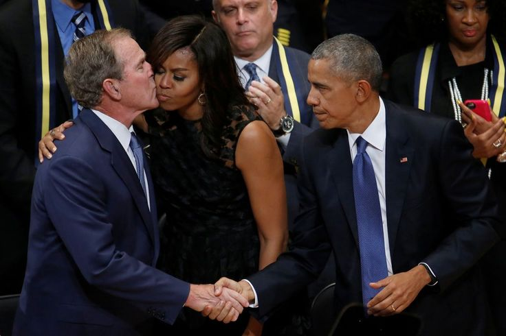 Former President George W. Bush greets President Obama and first lady Michelle Obama during a memorial service for slain police officers in Dallas, July 12, 2016.  A former top aide to George W. Bush once explained the Republican's intriguing relationship with President Obama in the bond between those
