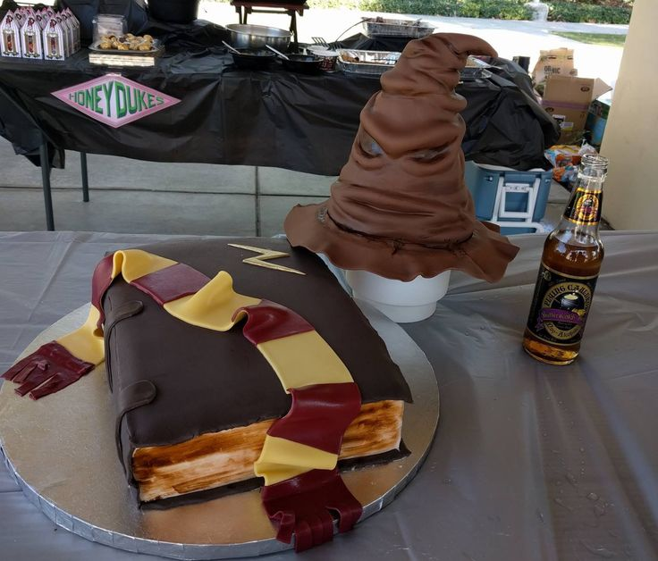 Harry Potter birthday cake with Gryffindor scarf and lightning bolt. Book of spells and sorting hat cake.