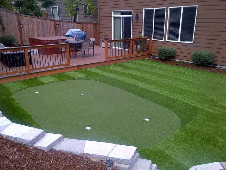 Trek deck, turf grass, fire pit and golf putting green - we definitely have room for this!