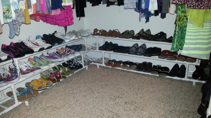 """Wife wanted a shoe rack for the closet... being the carpenter, let's just say I went a little overboard. Used 109 connectors and 120 feet of 1/2"""" PVC and a few hours. This thing is custom fit to hold 50 pairs of shoes and wraps around three walls of our walk in closet."""