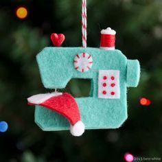 Inspiration felt Christmas decoration .Ho Ho Sew! Ornament PDF Betz White sewing machine santa hat