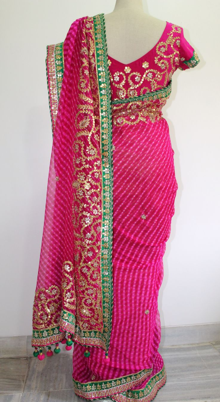Fuchsia Pink pure chiffon Lehariya saree with Gota patti work. It comes with a fushcia pink pure crepe unstitched blouse with gota work all over. To buy this saree drop a message.