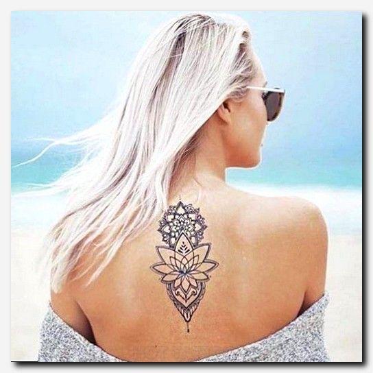 Tatouage De Femme Tatouage Fleur De Lotus Noir Et Gris Sur Dos
