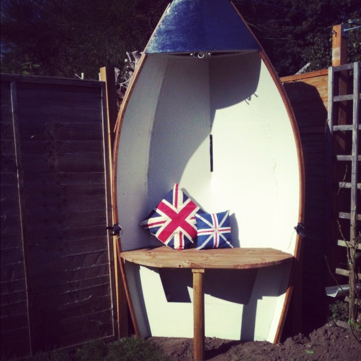 Old Rowing Boat Made Into A Seat Home By The Sea