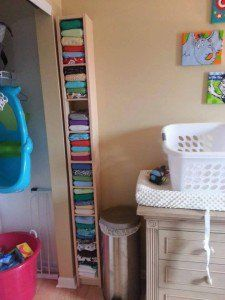 "Stacey S.: ""This is our diaper storage! Shelf is a dvd rack from ikea… and holds about 60 all in one diapers"""