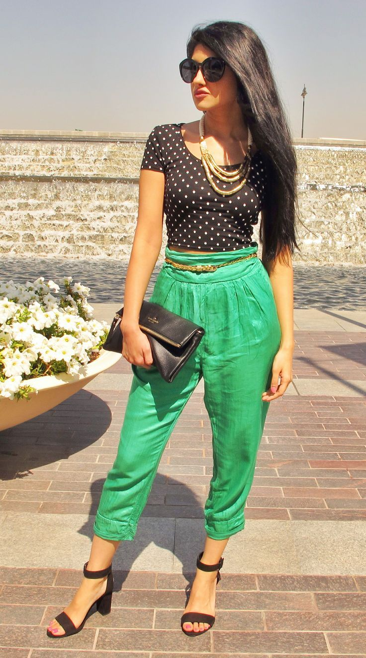 Cute polka dot top with green pants. Fashion street style trends.
