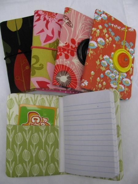 fabric journal with pocket! i didn't put a journal in it, but colored pencils, pencil sharpener, eraser, pencils, a glue stick and scissors to go in our OCC boxes.