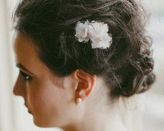 Handmade with individually pressed lace, silk and tulle petals adorned with a few simple pearls.