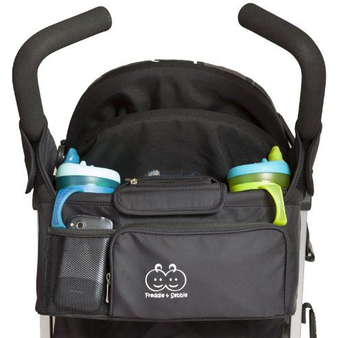 Stroller Organizer by Freddie and Sebbie - Deluxe, Luxury And Designer Black Baby Stroller Organizer - Comes With Extra Cup Holders Ideal for Drinks, Sippy Cups, Water Bottles, And Baby Bottles - Guaranteed To Keep Your Baby Stroller Accessories Safe And Secure With The Three Extra Pockets - Stays Firmly Fixed In One Place Like A Console - Universal And Designed To Fit Most Strollers - Protect Your Investment - Comes With A Lifetime Guarantee! Freddie and Sebbie ...