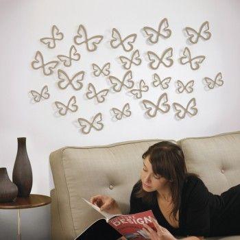 Zestaw 24 elementów dekoracyjnych Fliterbye holenderskiej marki Umbra. Produkt został wykonany z tworzywa sztucznego. Każdy z elementów można rozmieścić na ścianie w dowolny sposób. Tego rodzaju dekoracje ścienne nadają odpowiedni charakter wnętrzu.
