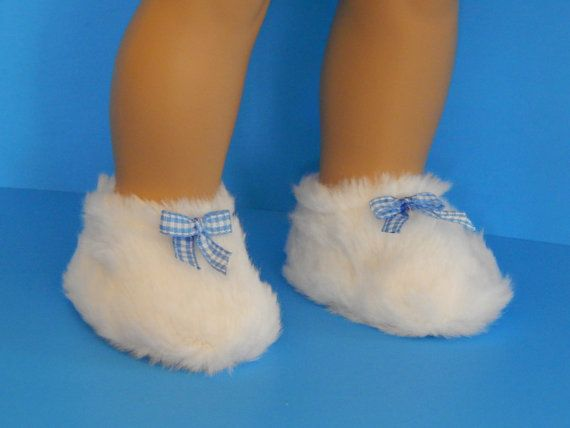 7.50 USD  These doll slippers for your favorite 18 inch doll were manufactured but embellished by me with a handmade blue and white checkered bow. They are canvas with a very fuzzy finish. So cute! There is something about these slippers that remind me of a fuzzy kitten. And like all my shoes every pair comes with a FREE gift box. They measure 3 x 1 3/4.  Doll Slippers - 18 inch Doll - Doll White Slippers - Doll Fuzzy Slippers - Doll Shoes - Slippers for Dolls - Gifts for Girls - Girls Toys…