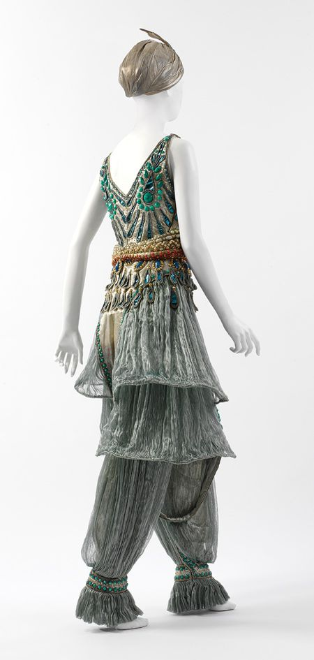 Fancy dress costume, 1911 Paul Poiret (French, 1879–1944) Seafoam green silk gauze, silver lamé, blue foil and blue and silver coiled cellophane cord appliqué, and blue, silver, coral, pink, and turquoise cellulose beading; L. (a) 50 1/4 in. (127.6 cm)