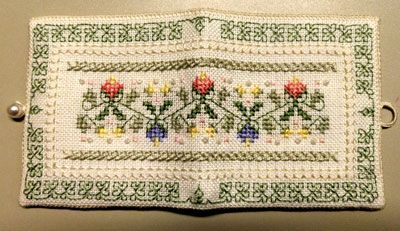 This is a lovely needle case - one of many classes you may find at www.embroiderersguildvic.org  it has cross stitch, four sided stitch and blackwork.  A great little project to learn some basic stitches.