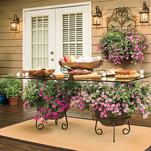 82 Creative Container Gardens | Trailing Petunias | SouthernLiving.com: Plants Can, Container Gardens, Tables Based, Outdoor Parties, Tables Flower, Outdoor Tables, Patio Tables, Dining Tables, Glasses Tables
