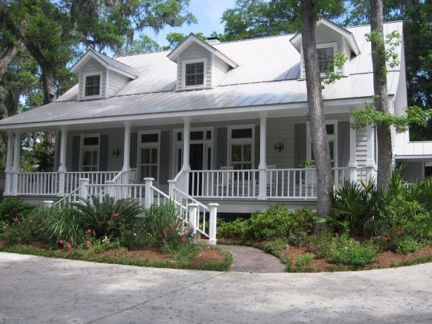 Love, love this house!! Isn't that porch amazing??  Wonderful Low Country style home located in desirable Black Banks on St. Simons Island.  Very private four bedroom, 4 1/2 bath home with beautiful landscaping and rocking chair front porch. Kitchen includes beamed and bayed morning room, charming Butler's pantry, and Travertine tile in kitchen and baths. Great room features wood burning fireplace with gas starter and french doors to deck area. Heated pool and spa with outdoor kitchen and…