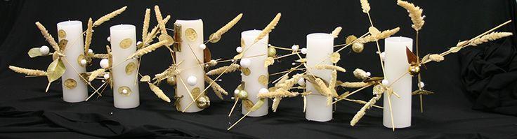 Pinned Pillar candles are very cool! www.blog.floraldesignmagazine.com #flowers #candles #Christmas #DIY #weddings #Xmas #floraldesign #flowerdesign