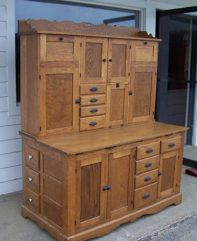 HOME DECOR – FURNITURE – CABINET – an antique oak hoosier kitchen baker's cabinet from the general country store restaurant.