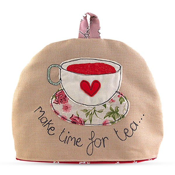 Poppy Treffry.  Applique textiles.  Her work is very much a celebration of our British love of tea drinking and living by the sea in Cornwall.  See also: http://www.youtube.com/watch?v=ylMy6QdsZr4