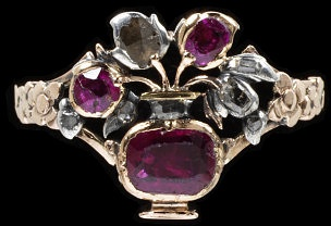 Ring. England. 1730. Flowers were a fashionable theme in jewellery from about 1750 to 1800. Intricate and colourful giardinetti('little garden') rings were popular. They had tiny blossoms set with an assortment of precious stones and asymmetrically arranged in a basket, vase or pot. Gold, silver, diamonds and rubies.