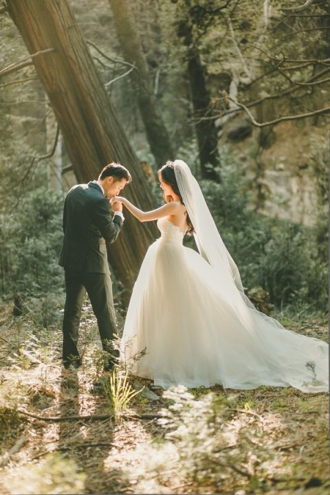 Fairy Tale Moment with the Bride and Groom   Kristin Booth Photography   http://heyweddinglady.com/enchanting-mountain-bridal-portraits/