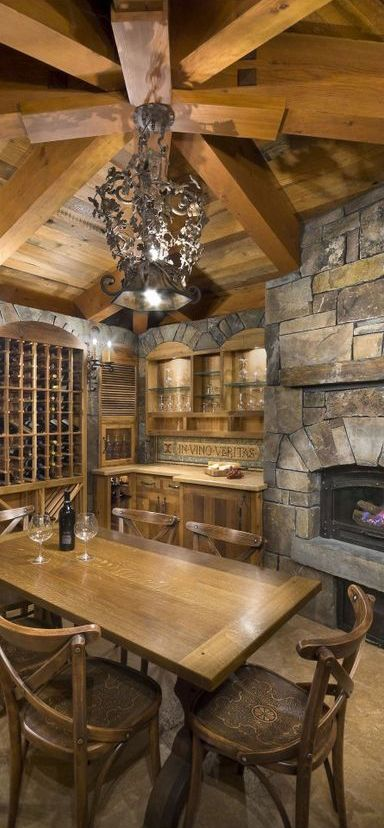 For the love of rustic cabin kitchens! Who wouldn't want a fireplace in their kitchen!!!