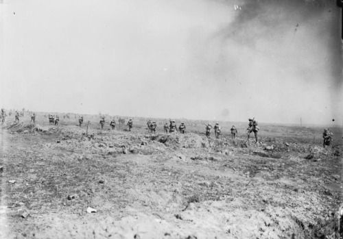 The Battle of Ginchy, Somme, France. British supporting infantry walk forward up the slope into the bombardment, 1916.