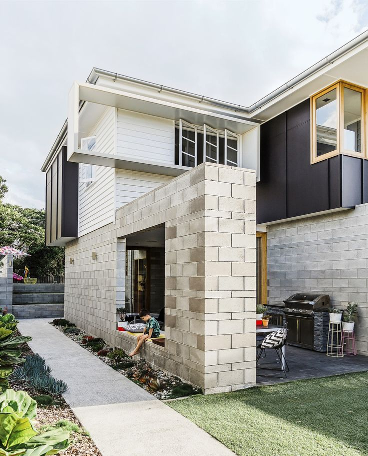 """Breeze blocks not only form a striking entrance, but also ensure this flood-prone home can withstand damage from rising waters. See more of this [renovated post-war cottage in Brisbane](http://www.homestolove.com.au/gallery-laura-and-alistairs-contemporary-family-home-1719