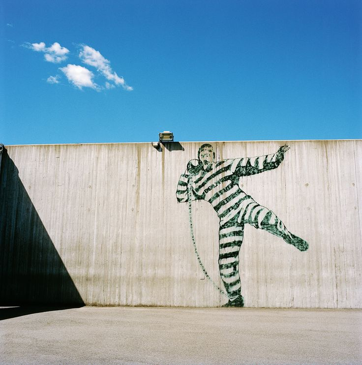 Even prisons are subject to Norway's requirement that every building receiving public money have some sort of public art. Here, a mural by the pseudonymous graffiti artist Dolk in an exercise yard at Halden Fengsel. Credit Knut Egil Wang for The New York Times.