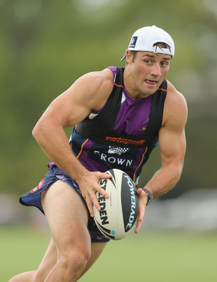 Cooper Cronk of the Storm runs with the ball during a Melbourne Storm NRL training session at Gosch's Paddock on January 25, 2013 in Melbourne, Australia.