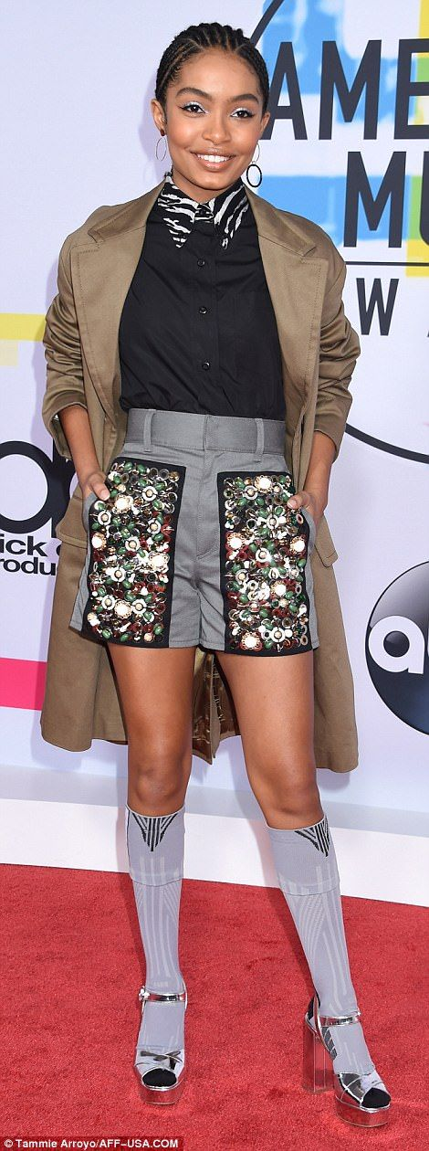 Striving for a one of a kind look: Yara Shahidi (l) donned embroidered shorts with a zebra accented top, adding a jacket, knee-high socks and silver heels; Sabrina Carpenter (r) cut a stylish figure in her plaid frock, adding cream thigh-high boots
