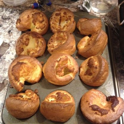 Yorkshire Pudding : In blender, blend (no lumps) 4 lg eggs, 1.5c whole milk, 1/2tsp salt, 1.25c flour. Put in lg. spouted measuring cup; cover, refrig. at least 30min (up to 24hrs) til cold. Stir batter before using. Put 2tsp sunflower (or canola) oil (or beef drippings) in each of 12-16 muffin cups; put in 450deg oven til very hot (10min). Quickly & carefully fill cups 2/3full (should really sizzle); bake on ctr rack about 25min til dark golden crisp (DONT open door).